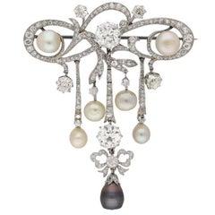 Edwardian natural pearl and diamond pendant/brooch, circa 1905.