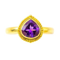 Pear Shaped Amethyst in Detailed Gold Bezel Ring