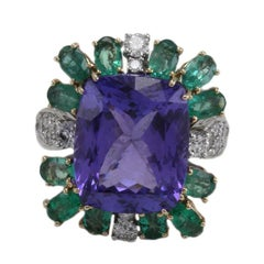 Ct 14,07 Tanzanite Ct 2,55 Emerald and Ct 2,29 Diamond Two Color Gold Ring