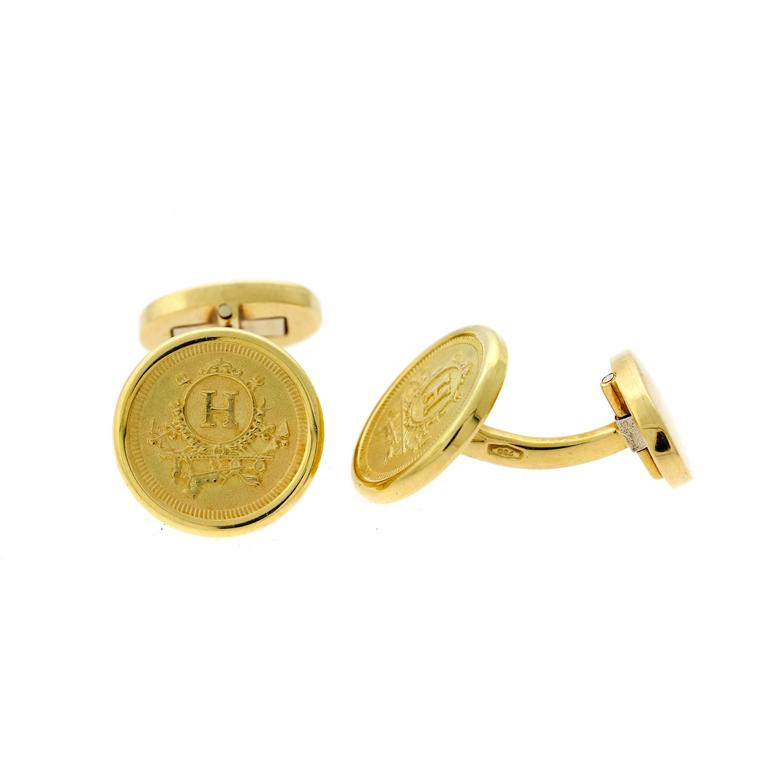A fabulous pair of authentic Hermes cufflinks crafted in 18k yellow gold.