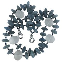 Two Strand Necklace of Aquamarine Rondels accented with Frosted Quartz Crystal