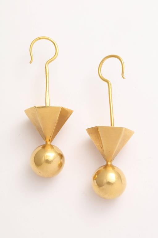 A pair of 18kt yellow gold tribal earrings  Length:2.30 inches Width: .80 inch