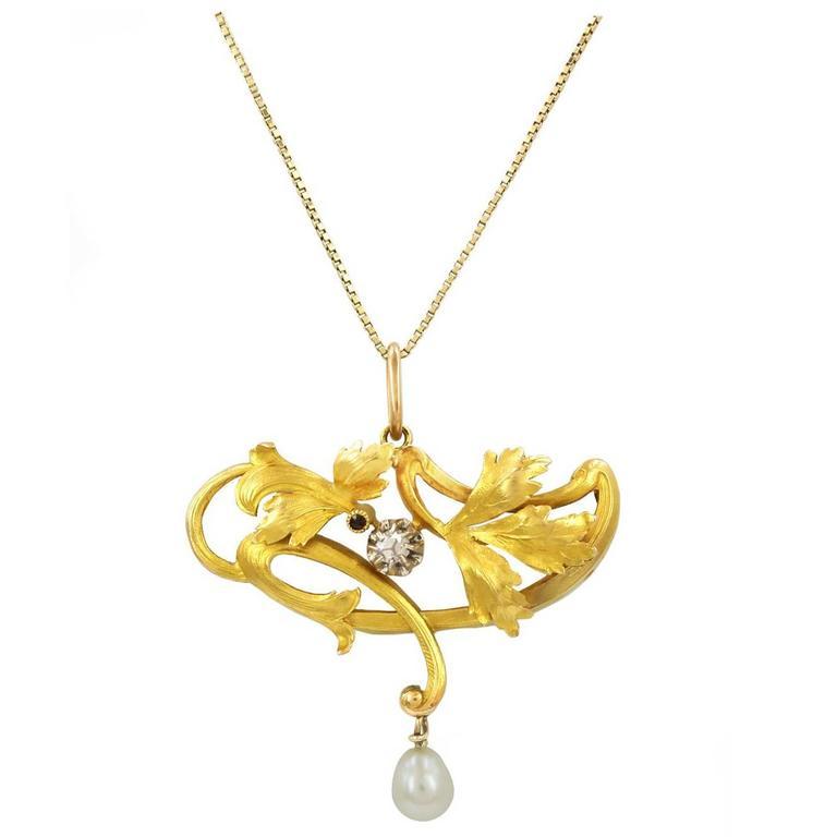 Art Nouveau Gold Diamond, Ruby and Pearl drop Pendant