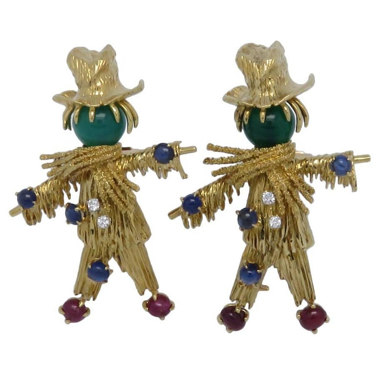 Van Cleef & Arpels Whimsical Gem Set Gold Scarecrow Brooches.