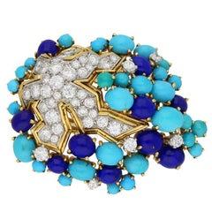 Boucheron Paris turquoise, lapis and diamond brooch, circa 1960.