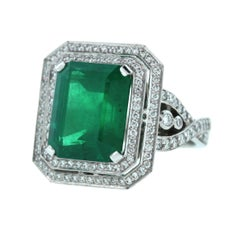 GIA Report 7.00 Carat Emerald Diamond Platinum Ring
