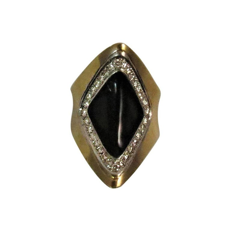 18 Karat Yellow Gold Diamond and Black Onyx Ring For Sale