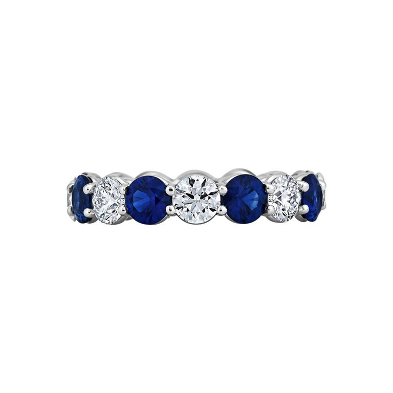 Round Diamond Sapphire and Platinum Band Ring