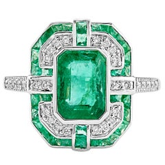 Geometric Design Octagon Emerald Diamond Ring