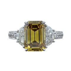 GIA Certified 4.21 Carat Fancy Yellow Emerald Cut Diamond Gold Ring