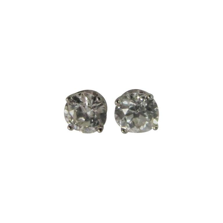 European Cut Diamond Stud Earrings Set In Platinum Four Prong Settings
