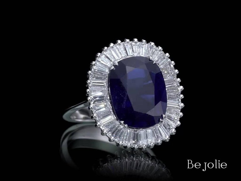 One of a Kind Ballerina Style Sapphire and diamonds ring starring 6.97 Carat natural blue sapphire. Our stunning Cushion Cut Sapphire surrounds with 36 Baguette cut diamonds 1.47 Carat TDW E-G VS.  Jewel Details:  6.97 Carat Cushion cut Blue