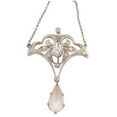 Antique Diamond and Moonstone Pendant set in Platinum and 14 Karat White Gold