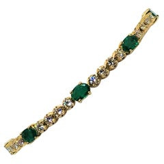 14 Karat Yellow Gold Emerald and Diamond Tennis Bracelet