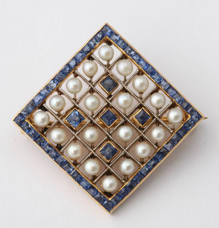 Women's or Men's Edwardian Pearl Sapphire and Gold Miniature Brooch, circa 1905 For Sale