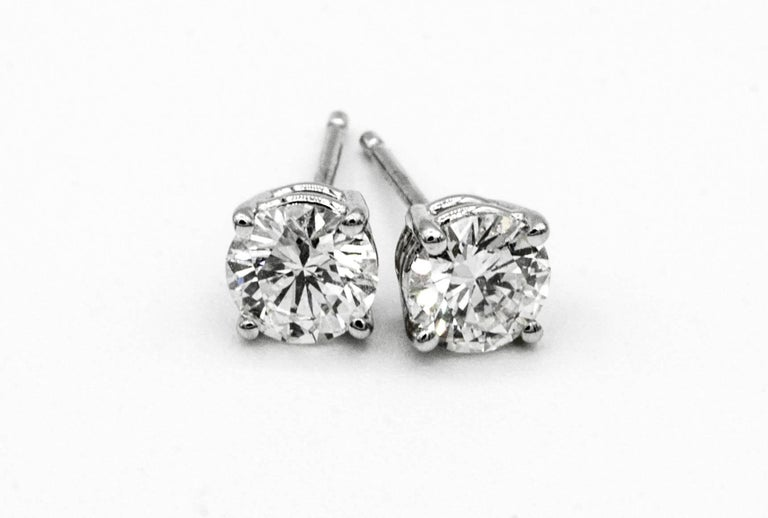 .91 Carat Diamond Stud earrings in 14K White Gold A pair of Diamond stud earrings weighing .91 Carats total.  Color is G SI1, and G VS2 ( EGL Certificates) 5.1 MM Diameter, beautifully cut and perfectly matched pair