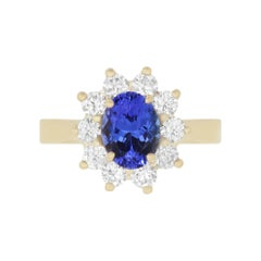 1.43 Carat Oval Shaped Tanzanite and 0.73 Carat White Diamond Ring