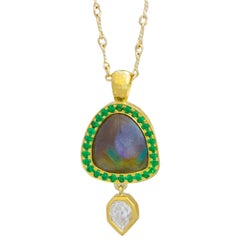 Rainbow garnet and tsavorite necklace in 18 k gold with a GIA empress diamond
