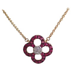14 Karat Yellow Gold Ruby and Diamond Flower Pendant Hangs from Cable Chain