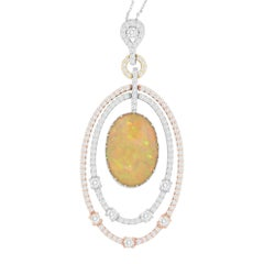 13.18 Carat Oval Opal and 1.90 Carat White Diamond Pendant