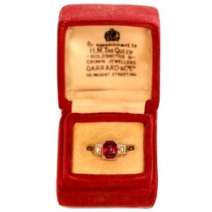 Garrards & Co Art Deco Ruby and Diamond Three Stone Platinum and Gold Ring