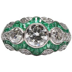 Handmade Platinum Contemporary 2.25 Carat Diamond and 2 Carat Emerald Ring