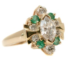 1950s 1.5 Carat Total Diamond, Emerald and Yellow Gold Marquise Cocktail Ring