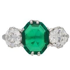 Edwardian old mine emerald and diamond three stone ring, circa 1910.