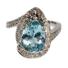 Fantastic 2.6 Carat Pear Cut Aquamarine Diamond Modern Swirl 18 Karat Ring