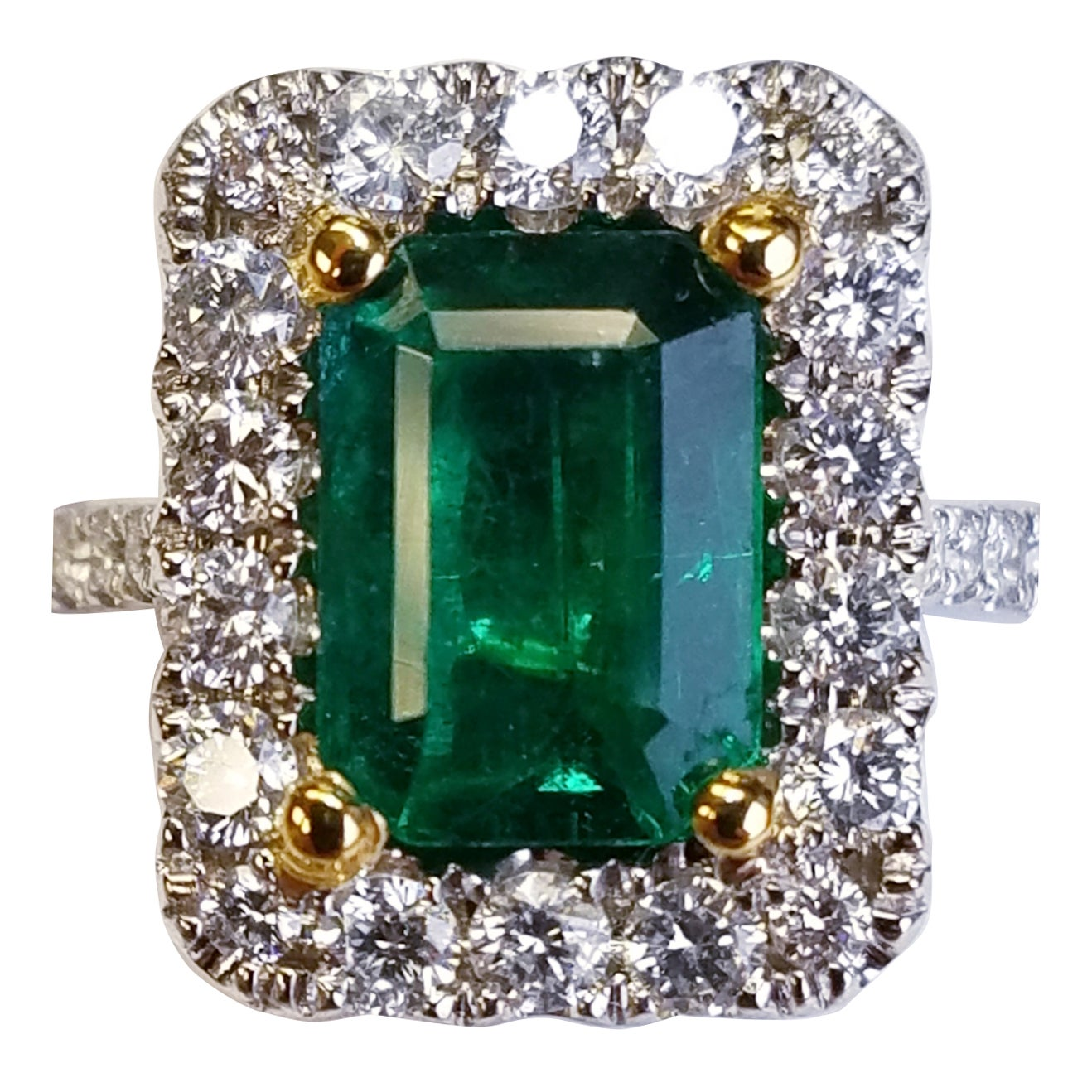 18 Karat White Gold Emerald Cut Emerald and Diamond Ring