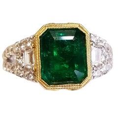 18 Karat White Gold Emerald Cut Natural Emerald and Diamond Ring