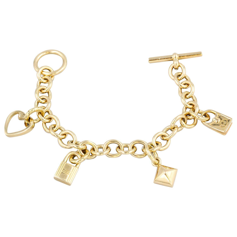 hermes gold charm bracelet for sale at 1stdibs