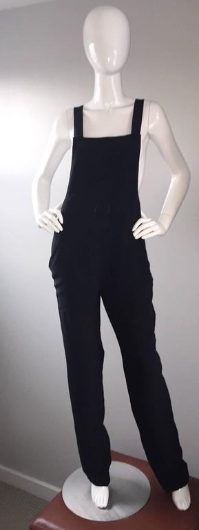 Super rare vintage 1990s brand new with tags FW 1997 Gucci, by Tom Ford black silk jumpsuit! So much style to this amazing piece, that has never been worn! Chic style, with a slouchy, yet fitted fit, and racerback. Three buttons on interior shoulder