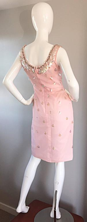 Sensational 1960s Lilli Diamond light pink chiffon dress, with pailletes, beads, and sequins embellished throughout. Brand new, with original store tags, this deadstock dress is simply divine in person! Beaded collar, with full metal zipper up the