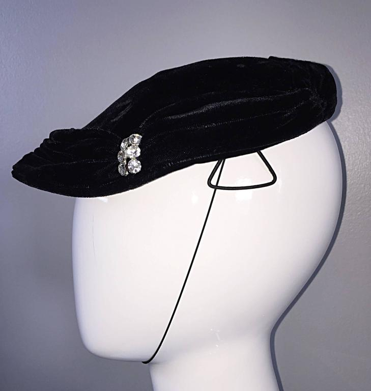 Beautiful 40s vintage black silk velvet hat! Features rhinestones at each front side, with intricate pleating. Chin strap, and side clamps ensures the hat stays on the head. In great condition. Will fit most sizes (Small-Medium/Large)