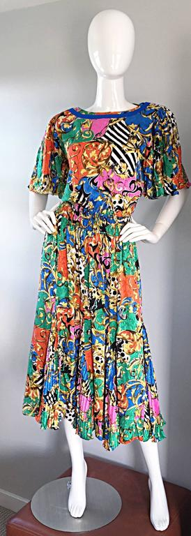 Amazing vintage Diane Freis / Diane Fres psychedelic colorful dress! Features a variety of prints throughout, including stripes and baroques. Pleated 'flutter' sleeves, with matching pleated skirt, that looks sensational on! As with most Diane Freis
