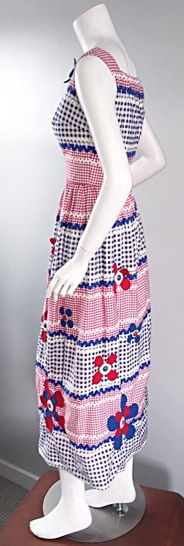 Amazing, IMPORTANT, and extremely rare 1960s Malcolm Starr, by Gino Charles, Caspian Sea Collection cotton maxi dress! Red, white, and blue gingham, in a variety of sizes, with rick rack print edges. The most amazing part---Wool felt flower