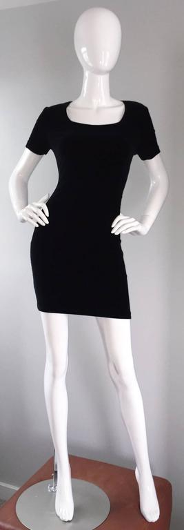 Sexy early 1990s Michael Kors, for Bergdorf Goodman, BodyCon black velvet mini dress! I cannot even begin to describe how flattering this little black dress is! Features short sleeves, with a scoop-like neckline. Stretches to fit. Great alone, yet