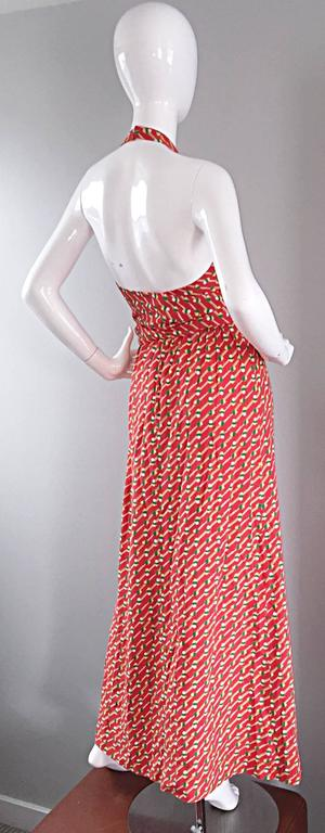 Incredible, and rare vintage Geoffrey Beene 'pill print' burnt orange maxi dress! Amazing jersey material, with a chic wrap-style closure. Attached tie sash belt. Incredible amount of detail, with a stunning fit! Hook-and-eye closures at back neck.