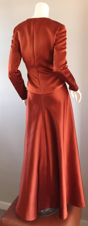 Exceptional vintage BILL BLASS copper colored silk satin evening gown! This dress surely is something else! Tailored long sleeves, with three silk covered buttons at each cuff. Full skirt, that looks amazing on! Slimming seams, with heavy attention
