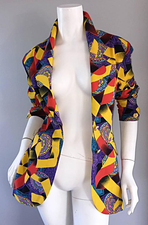 Wonderful vintage Roberto di Cabrini vintage ribbon and paisley print fitted cotton jacket! Features yellow and red ribbon print, amongst a purple, pink and blue paisley print. Gold decorated buttons down the bodice, and at each sleeve cuff. Two