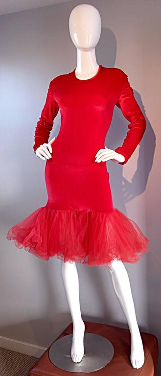 Amazing, and fabulous vintage Patrick Kelly early 90s dress! Red cotton velveteen with a long sleeve body con fit! Layers and layers of wonderful red silk tulle at hem, that jets out, creating a shorter mermaid hem. SO avant garde, yet a timeless