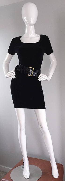 Brand new vintage Jane August gator embossed black patent leather belt! Substantial width, that makes just the right statement. Oversized square gold buckle. The perfect black belt for jeans, a skirt, or over your favorite little black dress. The