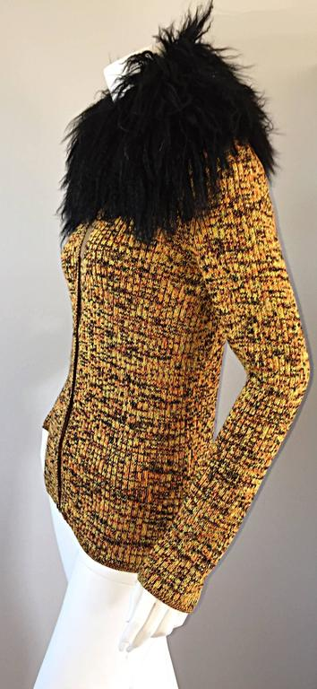 """Absolutely incredible, and rare vintage 1970s / 70s Yves Saint Laurent """"Fourrures"""" sweater cardigan! Features an oversized collar of black Mongolian lamb fur. Soft, fitted, and wonderfully stylish! Autumnal tones, that go great with practically"""