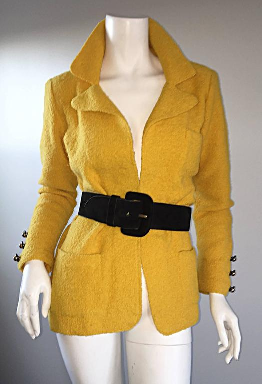 Excellent vintage Adolfo mustard yellow knit blazer jacket! Open front style, with three statement buttons at each cuff. Curved lapels, that add just the right amount of femininity. Features two pockets at both sides of waist, and one at left