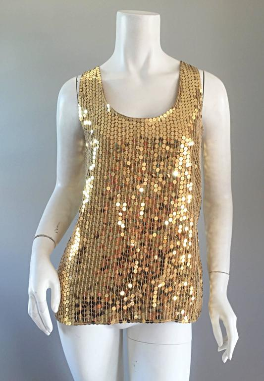 Wonderful vintage Oleg Cassini silk blouse, fully covered with gold sequins! Great shape, that is super versatile. Can easily transition from day to night. Great with jeans, shorts, or a skirt. Perfect alone, or belted. In great condition. Marked