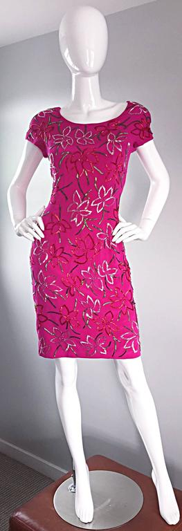 Wonderful in every aspect! Early 1990s CARMEN MARC VALVO hot pink silk dress! Encrusted with thousands of glass beads in red, green, silver, and pink, that form a tropical floral print throughout. Fantastic shape, that flatters the body in a
