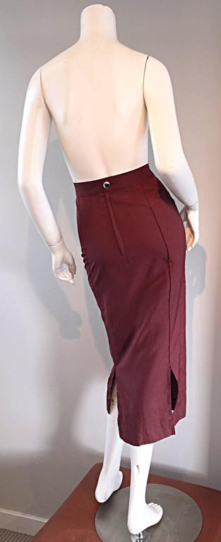 "Rare vintage Jean Paul Gaultier (early 1990s) high waisted BodCon pencil skirt. From his ultra chic "" Junior "" label, this skirt features so much detail. Double slits in the back show just the right amount of leg. Burgundy color, with a"