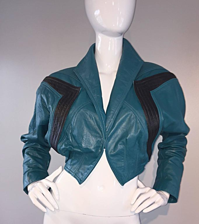 Amazing avant garde vintage 80s Kelli Kouri teal blue cropped leather bolero jacket! Amazing style, with panels of black at shoulders. Great construction, with a collar that can be down, or popped up, and sleeves ruched up for a more fashion-forward