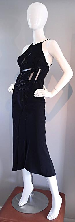 Gorgeous vintage LILLIE RUBIN black silk dress!!! Heavy attention to detail on this well made dress! Features cut-outs on the front, which are lined with black mesh. There is also one in the back. Fully beaded straps, that criss-cross in the back